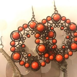 3 earrings: 1st is more coral than red